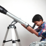 kid on microscope